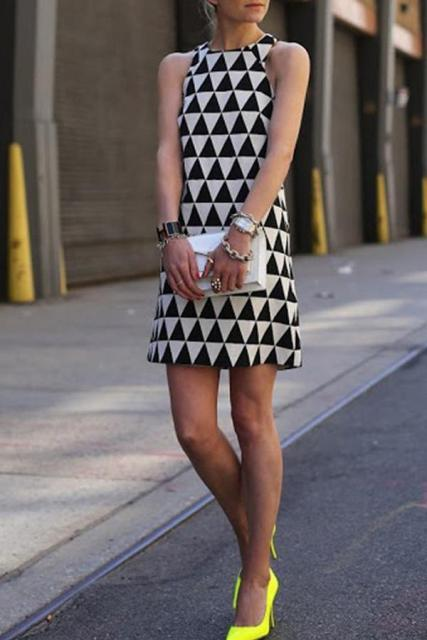 With white clutch and yellow pumps
