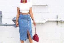 With white crop t-shirt, pink bag and high heels
