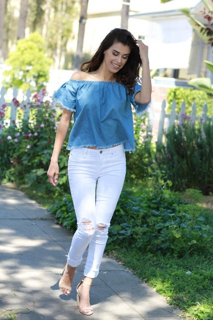 With white distressed pants and beige high heels