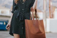 With white hat and brown leather tote bag