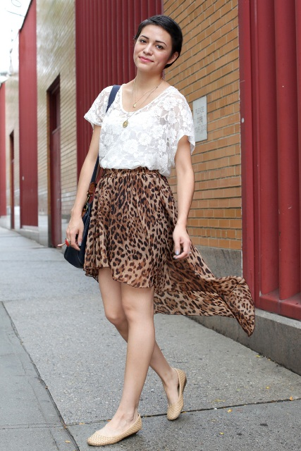 With white lace shirt, black bag and beige flat shoes