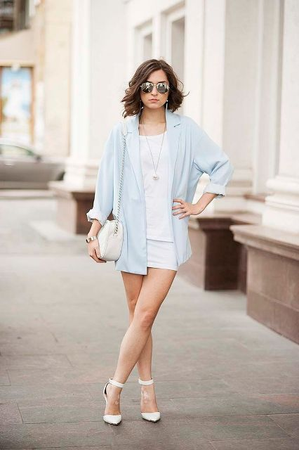 With white loose shirt, mini skirt, chain strap bag and white ankle strap high heels
