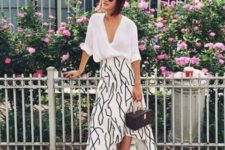 With white loose shirt, printed bag and white sneakers