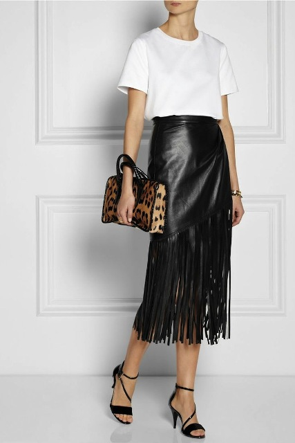 With white loose t-shirt, leopard printed bag and black heeled shoes