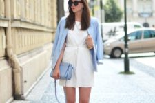 With white mini dress, light blue bag and white pumps