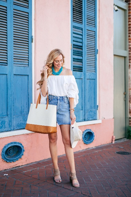 With white off the shoulder blouse, white and brown tote bag, white hat and gray sandals