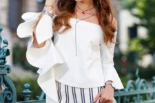 With white off the shoulder ruffled blouse and striped shorts