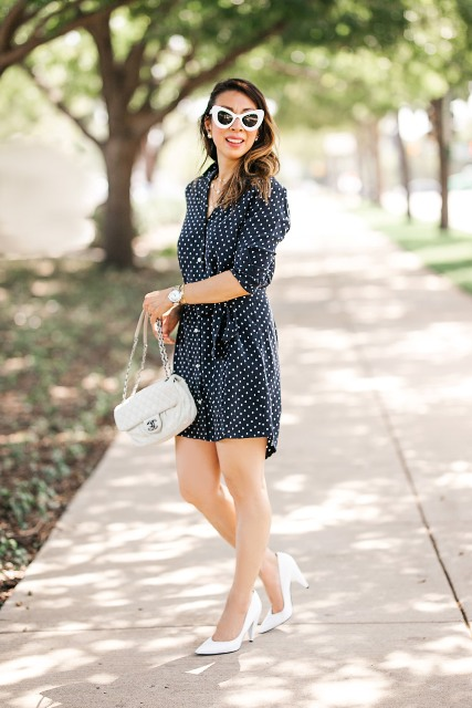 With white pumps, white framed sunglasses and light gray bag
