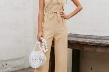 With white rounded bag and ankle strap shoes