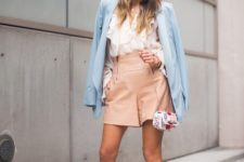 With white ruffled blouse, beige high-waisted shorts, printed mini bag and white high heels
