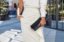 With white ruffled midi skirt and black clutch