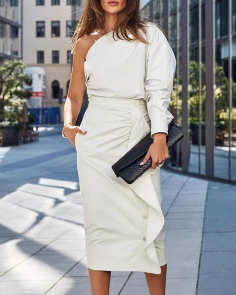 With white ruffled midi skirt and black clutch