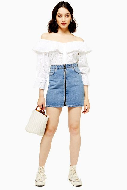 With white ruffled off the shoulder blouse, white bag and beige sneakers