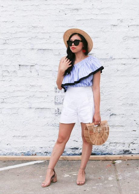 With white shorts, straw hat, straw bag and beige sandals