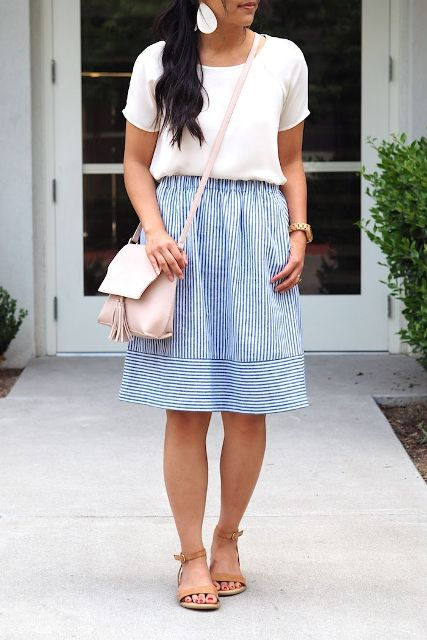 With white t-shirt, striped knee-length skirt and brown flat sandals