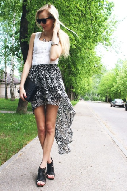 With white top, black clutch and black cutout shoes