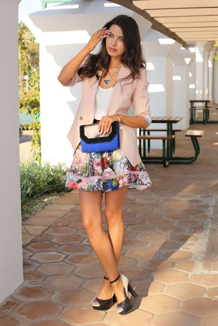 With white top, floral mini skirt, three colored bag and white and black high heels