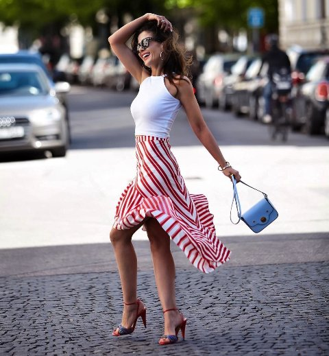 With white top, red and white midi skirt and two colored high heels