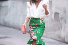 With white wrap blouse, clutch and beige lace up shoes