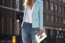 With white wrap blouse, silver clutch, loose jeans and silver shoes
