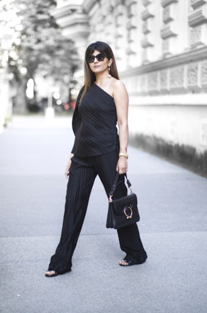 With wide leg pants, sandals and bag