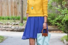With yellow sweatshirt, blue skirt and leopard flat shoes