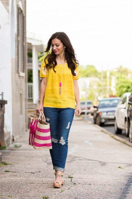 Wtih distressed jeans, striped tote bag and platform sandals