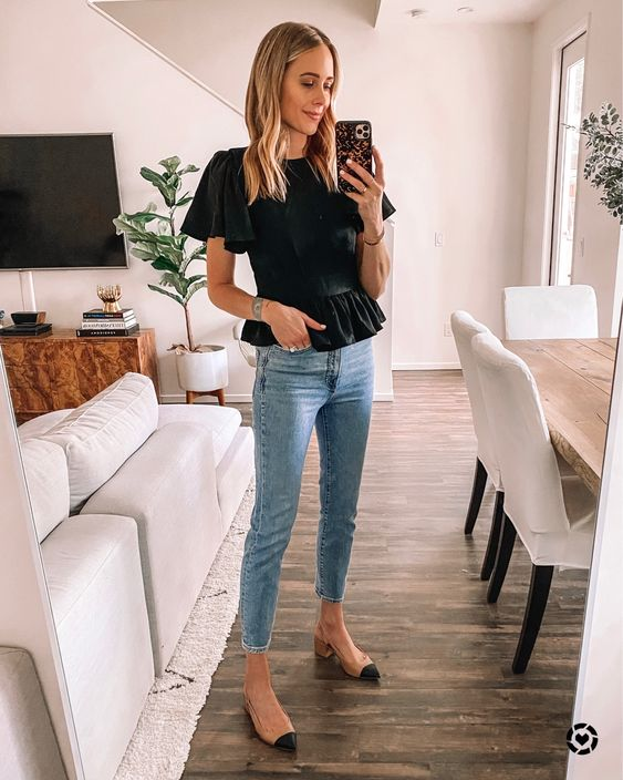 a black peplum top with short sleeves, blue skinnies, two tone slingbacks for a work look