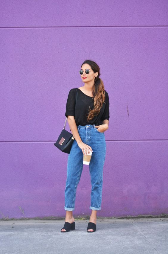 a black tee, blue cuffed jeans, black heeled mules and a black bag to wear every day
