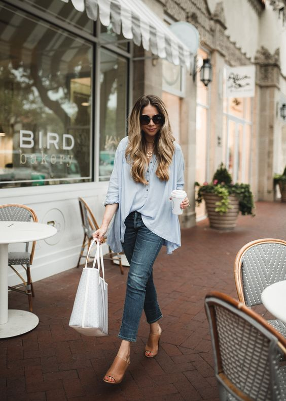 a blue chambray shirt, cropped jeans, tan heeled mules, a white tote for a chic spring look