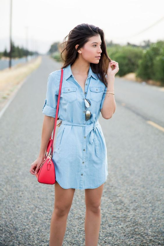a blue chambray shirtdress with short sleeves, a red bag and sunglasses for this summer