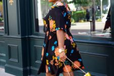 a bold look with a black floral print knee dress, mustard block heels and a fun citrus bag just wows