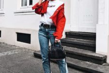 a bright summer look with a white tee, a red cropped denim jacket, blue jeans, white sneakers and a black bag
