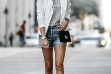 a casual look with a grey tee, blue denim shorts, a white blazer, a black crossbody and mules