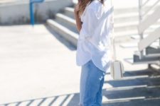a casual look with a white shirt, blue jeans, sunny yellow heeled mules for a bold touch and a white bag