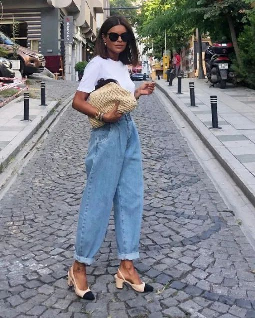 a casual look with a white tee, blue baggy jeans, two tone slingbacks and a wicker clutch for summer