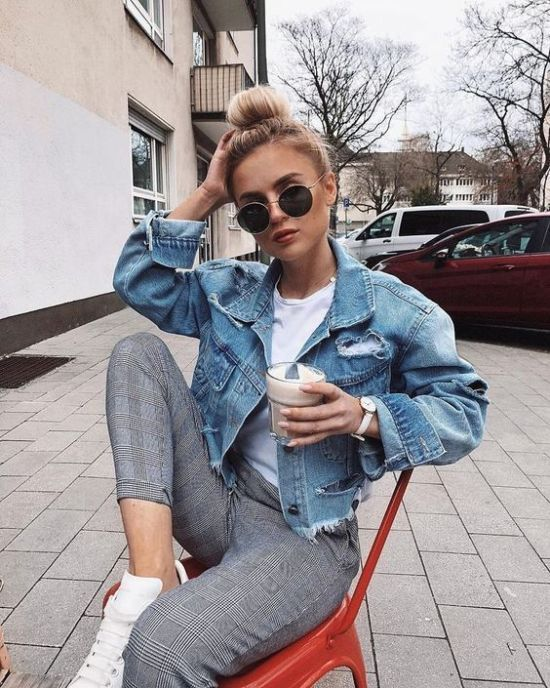 a casual look with a white tee, grey plaid cropped pants, a blue ripped denim jacket and white sneakers