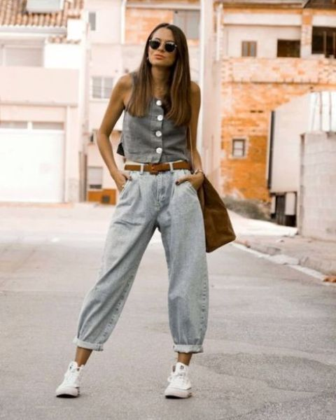 a casual outfit with baggy jeans, a denim button up top, white sneakers and a suede top