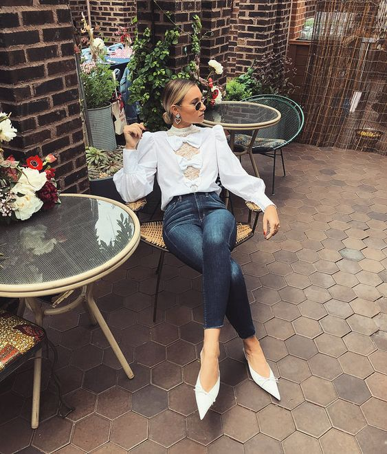 a chic outfit with a white bow puff sleeve blouse, skinnies, white pointed toe shoes