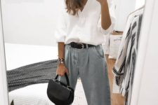 a chic outfit with a white linen shirt, baggy jeans, silver heels and a small black bag