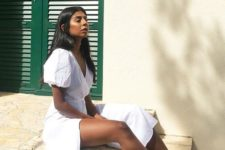 a comfortable white cotton midi wrap dress with puff sleeves is perfect for a hot day