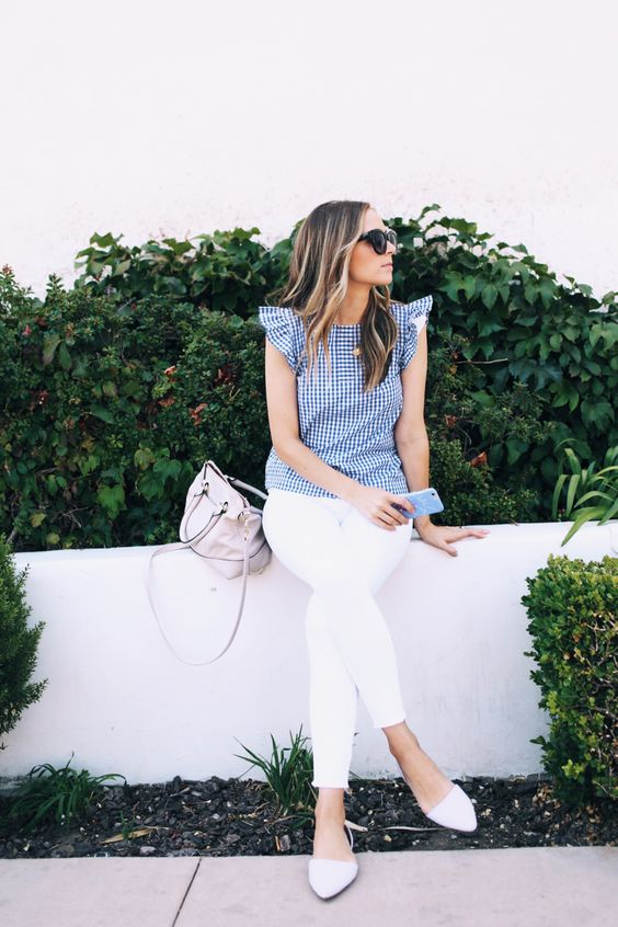 a cute outfit with white jeans, a plaid ruffle cap sleeve top, white flats and a neutral bag