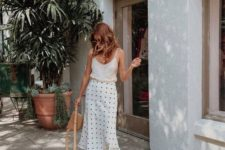 a cute summer look with a white thin strap top, a polka dot satin midi, white square toe sandals and a brown bag