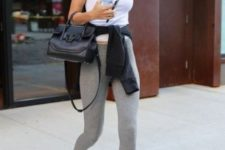 a daily look by Gigi Hadid – a white tank top, grey leggings, black and white trainers and a small bag