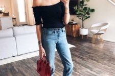 a date look with a black off the shoulder top, blue cropped skinnies, two tone slingbacks and a red bag