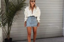 a date look with an embellished oversized blouse, a short blue denim skirt, white pointed toe shoes