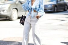 a date outfit with a blue tied up shirt with puff sleeves, white jeans, brown heeled mules and a black bag
