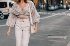 a floral cropped blouse with puff sleeve, tan pants, silver shoes and a neutral bag for a bold look