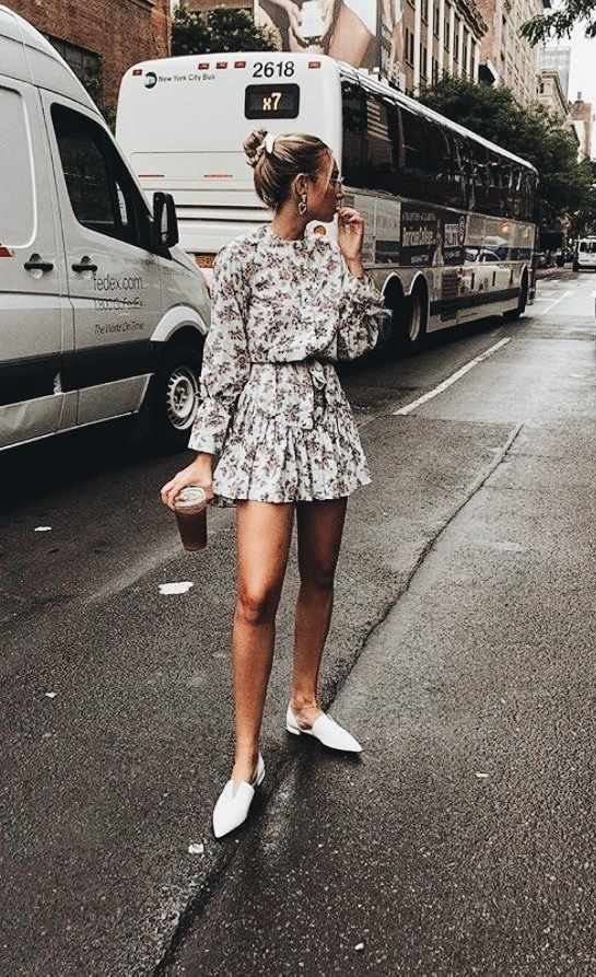 a floral mini dress with a high neckline, long sleeves and white pointed toe kitten heels