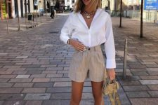 a glam look with a white shirt, tan striped mini shorts, pink shoes and a tiny bag for summer